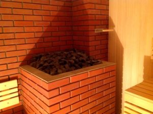Чем отделать стены в бане возле печки